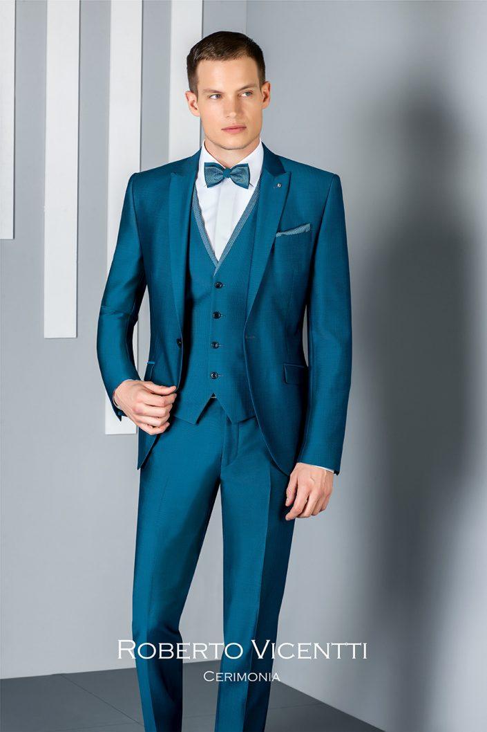 Costume de marié bleu canard avec gilet et noeud papillon