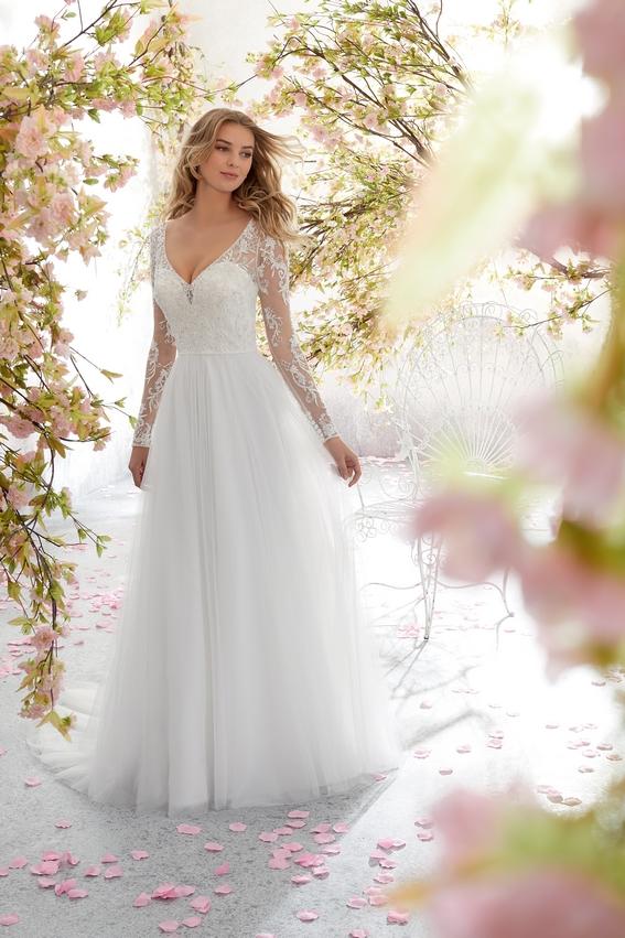 Robe de mariée tendance en dentelle avec manches longues, décolleté plongeant et dos nu